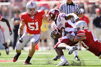 COLUMBUS, OH - OCTOBER 9:  Ross Homan #51 of the Ohio State Buckeyes moves in to assist on a tackle against the Indiana Hoosiers at Ohio Stadium on October 9, 2010 in Columbus, Ohio.  (Photo by Jamie Sabau/Getty Images)