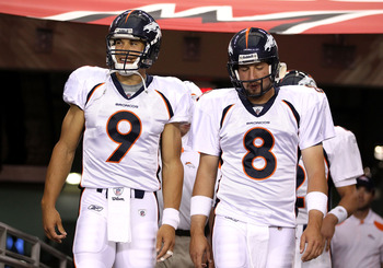 GLENDALE, AZ - SEPTEMBER 01:  Quarterbacks Brady Quinn #9 and Kyle Orton #8 of the Denver Broncos walk out onto the field before the preseason NFL game against the Arizona Cardinals at the University of Phoenix Stadium on September 1, 2011 in Glendale, Ar