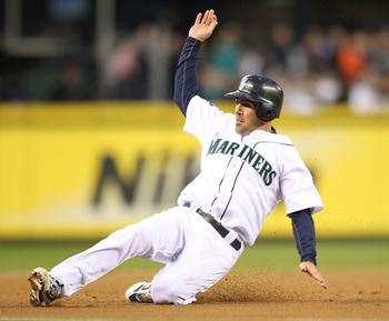 SEATTLE - APRIL 12:  Jack Wilson #2 of the Seattle Mariners steals third base against the Toronto Blue Jays at Safeco Field on April 12, 2011 in Seattle, Washington. (Photo by Otto Greule Jr/Getty Images)
