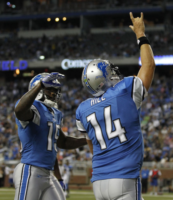DETROIT - AUGUST 12:  Quarterback Shaun Hill #14 of the Detroit Lions ran seven yards for a second quarter touchdown and celebrates with teammate Derrick Williams #15 during the game against the Cincinnati Bengals at Ford Field on August 12, 2011 in Detro