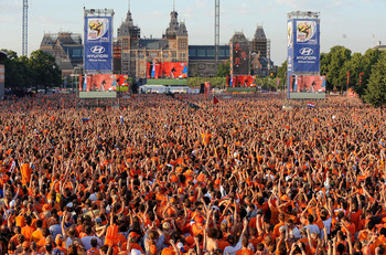 AMSTERDAM, NETHERLANDS - JULY 11:  Holland fans seem as a sea of orange as they watch the FIFA2010 World Cup final between Netherlands and Spain on a large screen near the Rijksmuseum on July 11, 2010 in Amsterdam, Netherlands.  (Photo by Christopher Lee/