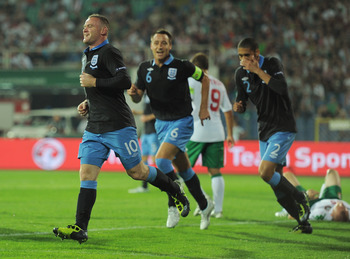 SOFIA, BULGARIA - SEPTEMBER 02:  Wayne Rooney of England celebrates scoring to make it 2-0 with John Terry and Chris Smalling during the EURO 2012 group G qualifying match between Bulgaria and England at the Vasil Levski National Stadium on September 2, 2