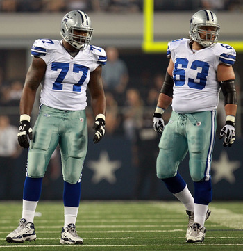ARLINGTON, TX - AUGUST 11:  Jason Witten #82, Tyron Smith #77 and Kyle Kosier #63 of the Dallas Cowboys at Cowboys Stadium on August 11, 2011 in Arlington, Texas.  (Photo by Ronald Martinez/Getty Images)