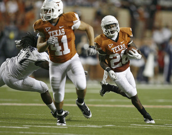AUSTIN, TX - SEPTEMBER 3:  Fullback Jamison Berryhill #41 leads the blocking for running back D. J. Monroe #26 of the Texas Longhorns and past defensive end Jared Williams #97 of the Rice Owls on a fourth quarter run on September 3, 2011 at Darrell K. Roy