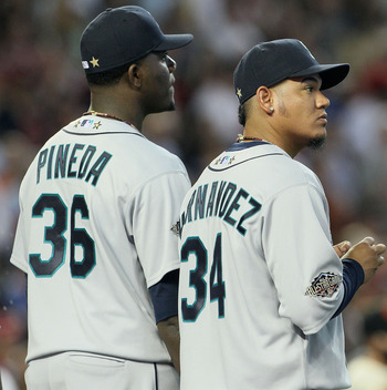 PHOENIX, AZ - JULY 12:  American League All-Star Michael Pineda #36 of the Seattle Mariners and American League All-Star Felix Hernandez #34 of the Seattle Mariners stand with American League All-Star Gio Gonzalez #47 of the Oakland Athletics before the s