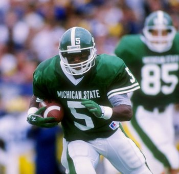 12 Oct 1991: Flanker Courtney Hawkins of the Michigan State Spartans runs down the field during a game against the Michigan Wolverines at Spartan Stadium in East Lansing, Michigan. Michigan won the game 45-28.
