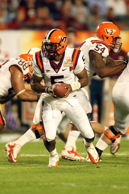 MIAMI, FL - JANUARY 03:  Tyrod Taylor #5 of the Virginia Tech Hokies turns to hand the ball off against the Stanford Cardinal during the 2011 Discover Orange Bowl at Sun Life Stadium on January 3, 2011 in Miami, Florida. Stanford won 40-12.  (Photo by Mik