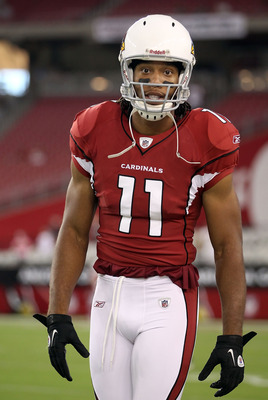 GLENDALE, AZ - SEPTEMBER 01:  Wide receiver Larry Fitzgerald #11 of the Arizona Cardinals warms up before the preseason NFL game against the Denver Broncos at the University of Phoenix Stadium on September 1, 2011 in Glendale, Arizona. The Cardinals defea