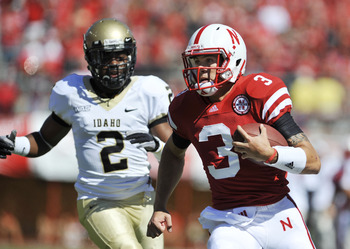 LINCOLN, NEBRASKA - SEPTEMBER 11: Nebraska Cornhuskers quarterback Taylor Martinez #3 runs for a touchdown past Idaho Vandals cornerback Kenneth Patten #2 during first half action of their game at Memorial Stadium on September 4, 2010 in Lincoln, Nebraska