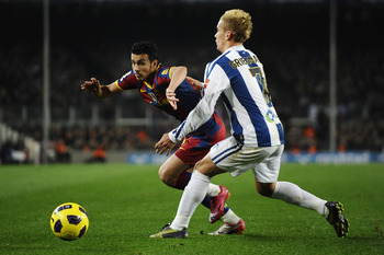 BARCELONA, SPAIN - DECEMBER 12:  Pedro Rodriguez of Barcelona (L) and Antoine Griezmann of Real Sociedad challenge for the ball during the La Liga match between Barcelona and Real Sociedad at Camp Nou Stadium on December 12, 2010 in Barcelona, Spain. Barc