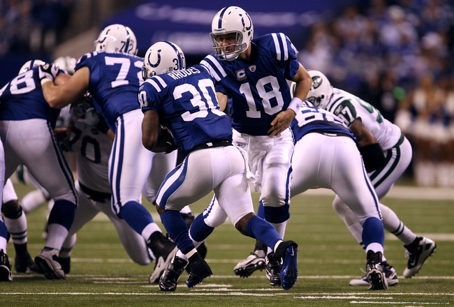 INDIANAPOLIS, IN - JANUARY 08:  Peyton Manning #18 of the Indianapolis Colts hands the ball off to Dominci Rhodes #30 against the New York Jets during their 2011 AFC wild card playoff game at Lucas Oil Stadium on January 8, 2011 in Indianapolis, Indiana.