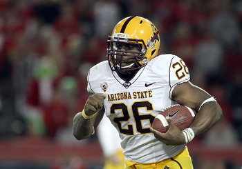 TUCSON, AZ - DECEMBER 02:  Runningback Cameron Marshall #26 of the Arizona State Sun Devils runs with the football during the college football game at Arizona Stadium on December 2, 2010 in Tucson, Arizona. The Sun Devils defeated the Wildcats 30-29 in do