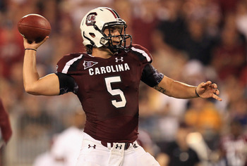 CHARLOTTE, NC - SEPTEMBER 03:  Stephen Garcia #5 of the South Carolina Gamecocks drops back to pass against the East Carolina Pirates during their game at Bank of America Stadium on September 3, 2011 in Charlotte, North Carolina.  (Photo by Streeter Lecka