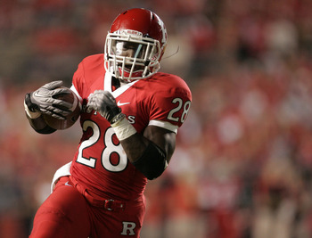 PISCATAWAY, NJ - SEPTEMBER 1: Savon Huggins of Rutgers Scarlet Knights runs for a touchdown against North Carolina Central Eagles during a college football game on September 1, 2011 at High Point Solutions Stadium in Piscataway, New Jersey. (Photo by Rich