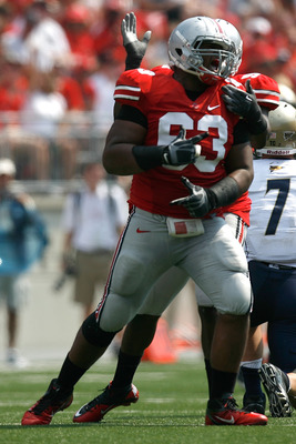 COLUMBUS, OH - SEPTEMBER 3:  Michael Bennett #63 of the Ohio State Buckeyes celebrates after sacking Patrick Nicely #7 of the Akron Zips during the third quarter on September 3, 2011 at Ohio Stadium in Columbus, Ohio. Ohio State defeated Akron 42-0. (Phot