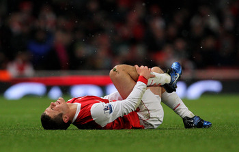 LONDON, ENGLAND - NOVEMBER 30:  Jack Wilshere of Arsenal lies on the ground during the Carling Cup quarter final match between Arsenal and Wigan Athletic at the Emirates Stadium on November 30, 2010 in London, England.  (Photo by Clive Rose/Getty Images)