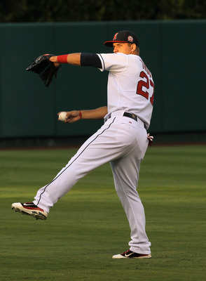 ANAHEIM, CA - AUGUST 19:  Outfielder Mike Trout #27 of the Los Angeles Angels of Anaheim warms up before the game with the Baltimore Orioles on August 19, 2011 at Angel Stadium in Anaheim, California.  (Photo by Stephen Dunn/Getty Images)