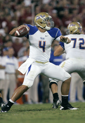 NORMAN, OK - SEPTEMBER 3:  Quarterback G.J. Kinne #4 of the Tulsa Hurricanes prepares to throw in the first half against the Oklahoma Sooners on September 3, 2011 at Gaylord Family-Oklahoma Memorial Stadium in Norman, Oklahoma.  Oklahoma defeated Tulsa 47