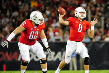Arizona Wildcats quarterback Nick Foles throws a pass while offensive guard Chris Putton blocks