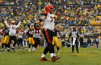 PITTSBURGH - DECEMBER 12: Andrew Whitworth #77 of the Cincinnati Bengals celebrates after scoring a touchdown against the Pittsburgh Steelers during the game on December 12, 2010 at Heinz Field in Pittsburgh, Pennsylvania.  (Photo by Jared Wickerham/Getty