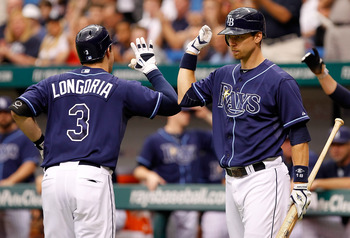ST. PETERSBURG, FL - SEPTEMBER 05:  Infielder Ben Zobrist #18 of the Tampa Bay Rays congratules Evan Longoria #3 after his home run against the Texas Rangers during the game at Tropicana Field on September 5, 2011 in St. Petersburg, Florida.  (Photo by J.