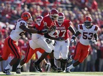 PISCATAWAY, NJ - NOVEMBER 25: Kenny Britt #88 of the Rutgers Scarlet Knights is grabbed by Tanard Jackson #28 of the Syracuse University Orange on November 25, 2006 at Rutgers Stadium in Piscataway, New Jersey. (Photo by Chris McGrath/Getty Images)