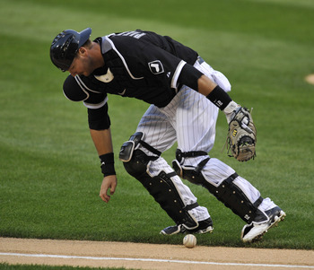 CHICAGO, IL - AUGUST 12: A.J. Pierzynski #12 of the Chicago White Sox fields a bunt against the Kansas City Royals on August 12, 2011 at U.S. Cellular Field in Chicago, Illinois.  (Photo by David Banks/Getty Images)