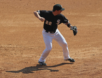 CHICAGO, IL - AUGUST 31: Brent Morel #22 of the Chicago White Sox throws the ball to 1st base against the Minnesota Twins at U.S. Cellular Field on August 31, 2011 in Chicago, Illinois. The Twins defeated the White Sox 7-6. (Photo by Jonathan Daniel/Getty