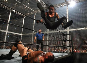 The Undertaker drops the big leg.