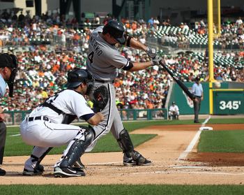 DETROIT, MI - SEPTEMBER 03: Paul Konerko #14 of the Chicago White Sox swings and makes contact during a MLB game against the Detroit Tigers at Comerica Park on September 3, 2011 in Detroit, Michigan.  (Photo by Dave Reginek/Getty Images)