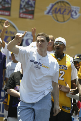 LOS ANGELES - JUNE 14: Mark Madsen #35 of the Los Angeles Lakers dances on stage in downtown Los Angeles following the victory parade on June 14, 2002 at Staples Center in Los Angeles, California.  The Lakers won their third consecutive NBA Championship t