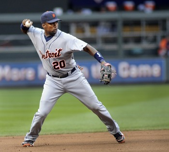 MINNEAPOLIS, MN - AUGUST 27: Wilson Betemit #20 third baseman for the Detroit Tigers throws a ground ball to first against the Minnesota Twins  in the sixth inning on August 27, 2011 at Target Field in Minneapolis, Minnesota. Detroit wins 6-4. (Photo by C