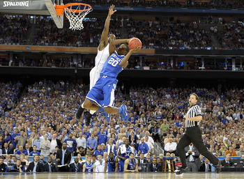 HOUSTON, TX - APRIL 02:  Doron Lamb #20 of the Kentucky Wildcats goes to the hoop against Kemba Walker #15 of the Connecticut Huskies during the National Semifinal game of the 2011 NCAA Division I Men's Basketball Championship at Reliant Stadium on April