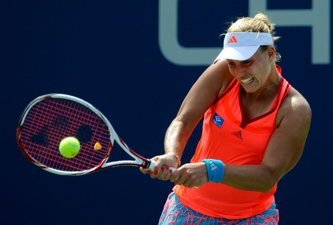 NEW YORK, NY - SEPTEMBER 04:  Angelique Kerber of Germany returns a shot Monica Niculescu of Romania aganst during Day Seven of the 2011 US Open at the USTA Billie Jean King National Tennis Center on September 4, 2011 in the Flushing neighborhood of the Q