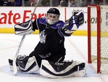 LOS ANGELES, CA - FEBRUARY 23:  Goaltender Dan Cloutier #39 of the Los Angeles Kings goes for the glove save on a shot in the first period by the Chicago Blackhawks at the Staples Center on February 23, 2008 in Los Angeles, California.  (Photo by Victor D