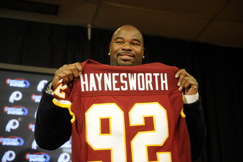Albert Haynesworth receiving a 7-year $100 million contract (2009).