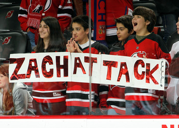 NEWARK, NJ - APRIL 02:  Fans hold a sign welcoming Zach Parise of the New Jersey Devils back from injury as the team skates in warm-ups before an NHL hockey game against the Montreal Canadians at the Prudential Center on April 2, 2011 in Newark, New Jerse