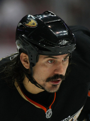 ANAHEIM, CA - JANUARY 02:  George Parros #16 of the Anaheim Ducks lines up in position prior to a faceoff against the Chicago Blackhawks at Honda Center on January 2, 2011 in Anaheim, California. The Ducks defeated the Blackhawks 2-1.  (Photo by Victor De