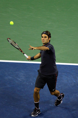NEW YORK, NY - SEPTEMBER 05:  Roger Federer of Switzerland hits a forehand against Juan Monaco of Argentina during Day Eight of the 2011 US Open at the USTA Billie Jean King National Tennis Center on September 5, 2011 in the Flushing neighborhood of the Q