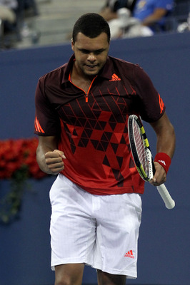NEW YORK, NY - SEPTEMBER 05:  Jo-Wilfried Tsonga of France reacts while playing against Mardy Fish of the United States during Day Eight of the 2011 US Open at the USTA Billie Jean King National Tennis Center on September 5, 2011 in the Flushing neighborh