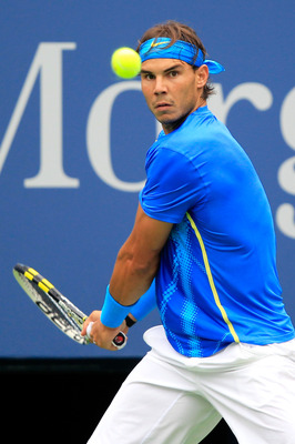NEW YORK, NY - SEPTEMBER 07:  Rafael Nadal of Spain returns a shot against Gilles Muller of Luxembourg during Day Ten of the 2011 US Open at the USTA Billie Jean King National Tennis Center on September 7, 2011 in the Flushing neighborhood of the Queens b