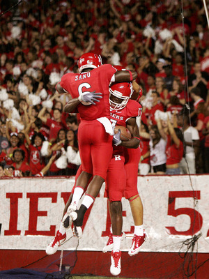 PISCATAWAY, NJ - SEPTEMBER 1: Brandon Coleman #17 of Rutgers Scarlet Knights celebrates a touchdown with teammates Mohamed Sanu #6 and Quron Pratt (back) during a college football game against North Carolina Central Eagles on September 1, 2011 at High Poi