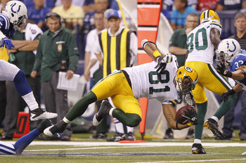 INDIANAPOLIS, IN - AUGUST 26: Andrew Quarless #81 of the Green Bay Packers dives for a first down during the first half of an NFL preseason game against the Indianapolis Colts at Lucas Oil Stadium on August 26, 2011 in Indianapolis, Indiana. (Photo by Joe