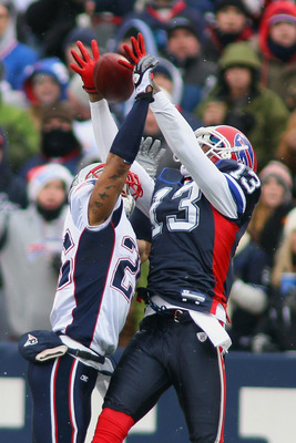 ORCHARD PARK, NY - DECEMBER 26: Patrick Chung #25 of the Patriots applies pressure on a pass intended for Steve Johnson #13 of the Buffalo Bills at Ralph Wilson Stadium on December 26, 2010 in Orchard Park, New York.  (Photo by Rick Stewart/Getty Images)