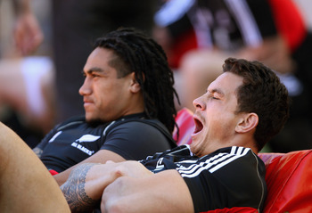 PORT ELIZABETH, SOUTH AFRICA - AUGUST 19:  Sonny Bill Williams of the All Blacks yawns as he watches the end of the All Blacks Captains Run with Ma'a Nonu at the Nelson Mandella Bay Stadium on August 19, 2011 in Port Elizabeth, South Africa.  (Photo by Ph