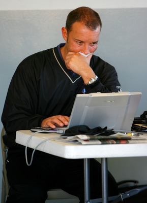 DAYTONA BEACH, FL - JANUARY 09: Chad Knauss, crew chief for the #48 Lowes Chevrolet driven by Jimmie Johnson working on his laptop in the garage during NASCAR testing at Daytona International Speedway on January 9, 2008 in Daytona Beach, Florida.  (Photo