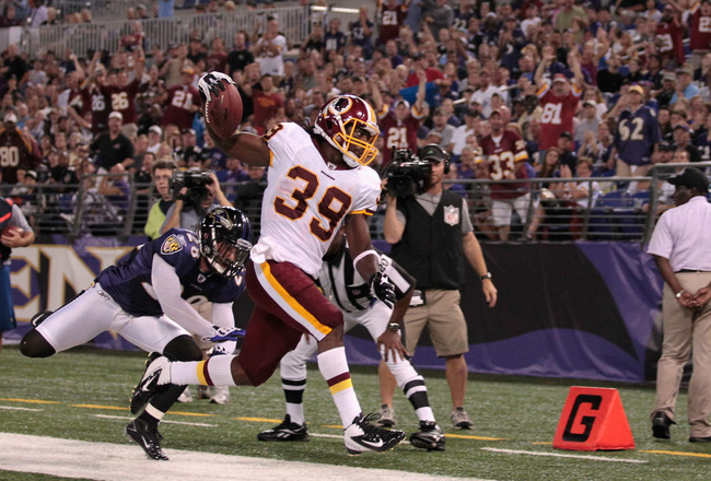 BALTIMORE, MD - AUGUST 25:  Tim Hightower #39 of the Washington Redskins scores a touchdown in front of Tom Zbikowski #28 of the Baltimore Ravens during the first half of a preaseason game at M&T Bank Stadium on August 25, 2011 in Baltimore, Maryland.  (P