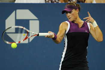 NEW YORK, NY - SEPTEMBER 04:   Samantha Stosur of Australia returns a shot againts  Maria Kirilenko of Russia during Day Seven of the 2011 US Open at the USTA Billie Jean King National Tennis Center on September 4, 2011 in the Flushing neighborhood of the
