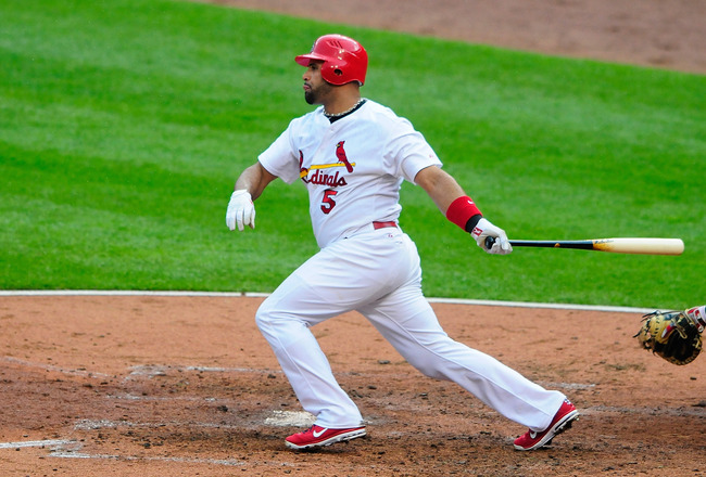ST. LOUIS, MO - SEPTEMBER 3: Albert Pujols #5 of the St. Louis Cardinals hits a one-run single against the Cincinnati Reds at Busch Stadium on September 3, 2011 in St. Louis, Missouri.  (Photo by Jeff Curry/Getty Images)