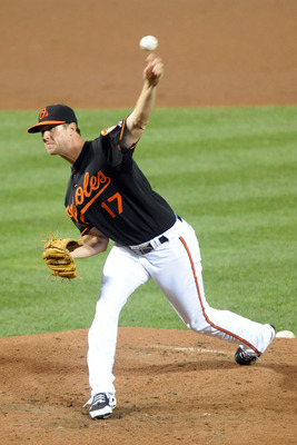BALTIMORE, MD - AUGUST 28:  Brian Matusz #17 of the Baltimore Orioles pitches during a baseball game against the New York Yankees at Oriole Park at Camden Yards on August 28, 2011 in Baltimore, Maryland.  (Photo by Mitchell Layton/Getty Images)